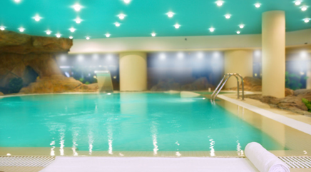 indoor commercial swimming pool with downlights