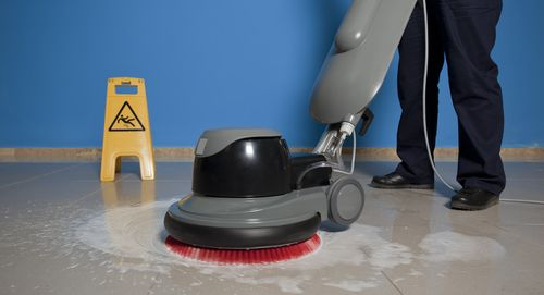Professional commercial cleaning team member polishing a floor in Honolulu, HI