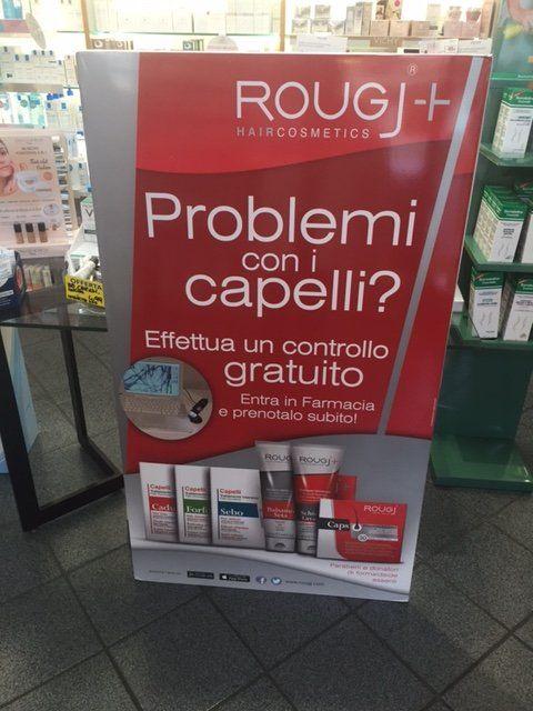 cartellone pubblicitario prodotti per capelli