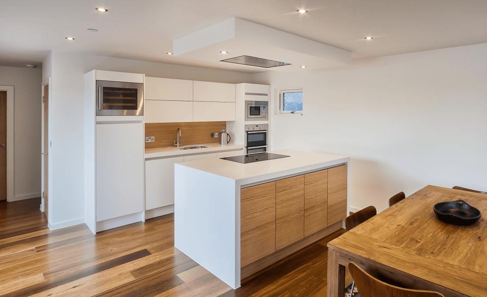 Modern minimalist kitchen with wooden table