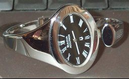 Accutron 230 ladies bangle watch after refinishing and rhodium plating at the time preserve