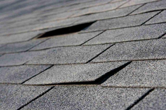 pealing roof tiles