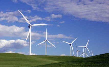 wind generators on a green hillside