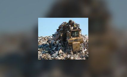 bulldozer moving landfill waste