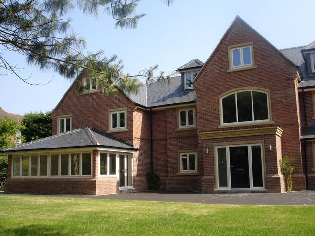 A woman looking at quality windows and doors in Grantham
