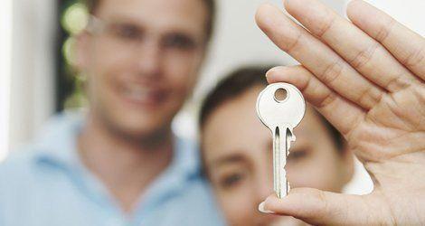 A woman holding a key