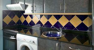Kitchen tile fitting