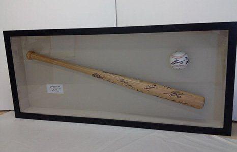 baseball in a frame