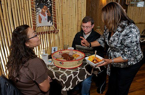 Customers enjoying traditional Ethiopian cuisine