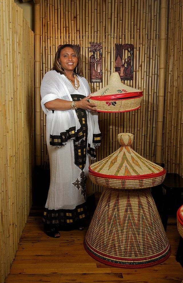 Woman holding traditional Ethiopian basket