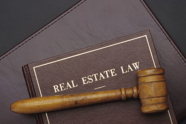 Real estate law book with gavel