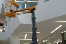 A cherry picker in a shopping centre