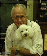 man holding Poodle
