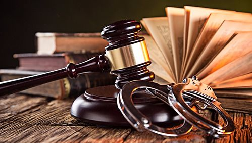 Gavel,handcuffs, and law books used for criminal cases in Wisconsin Rapids, WI