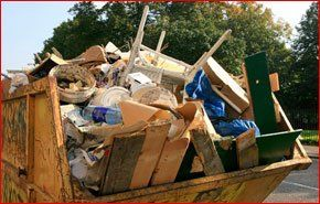 A skip filled to the brim with construction waste