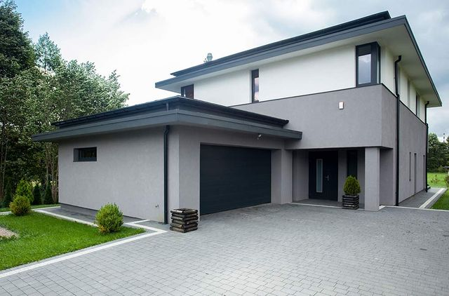 modern house with paved driveway