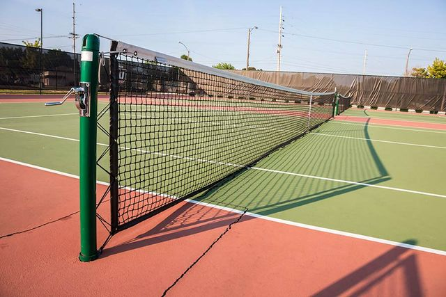 Tennis court view from the side of the net