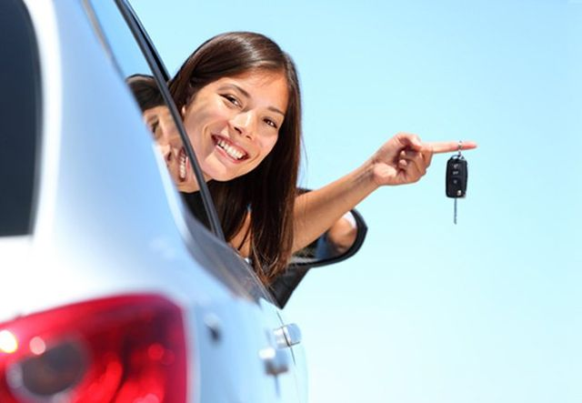 cheerful girl showing of her car keys