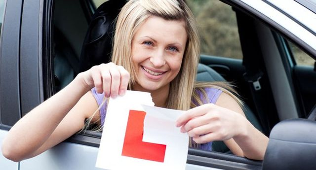 lady with a L sign board