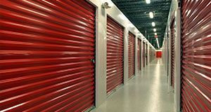 Inside of an warehouse with red storage rental units in Cincinnati