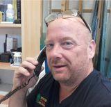 man using a landline phone