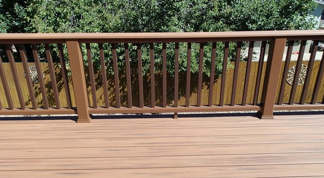 View of the composite railing system installed in Rough sawn cedar with railing in Denver, CO