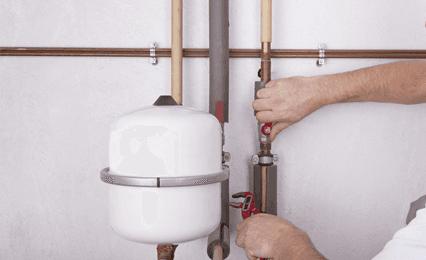 a plumber fixing a boiler