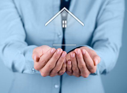 image of a graphic home on a mans palm