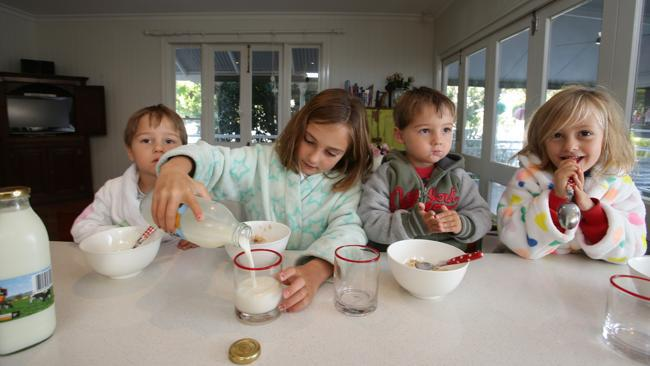 Children enjoying drinking milk