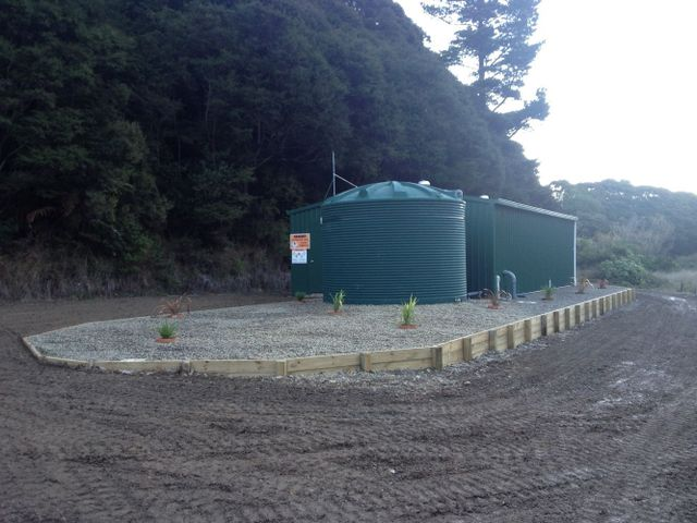 drainlaying experts working on a tank in Opotiki