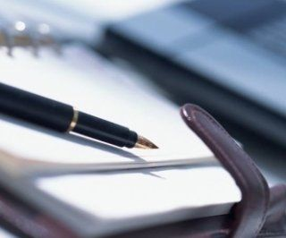 una penna e un quaderno
