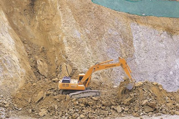 Clearing dirt and rock with heavy equipment