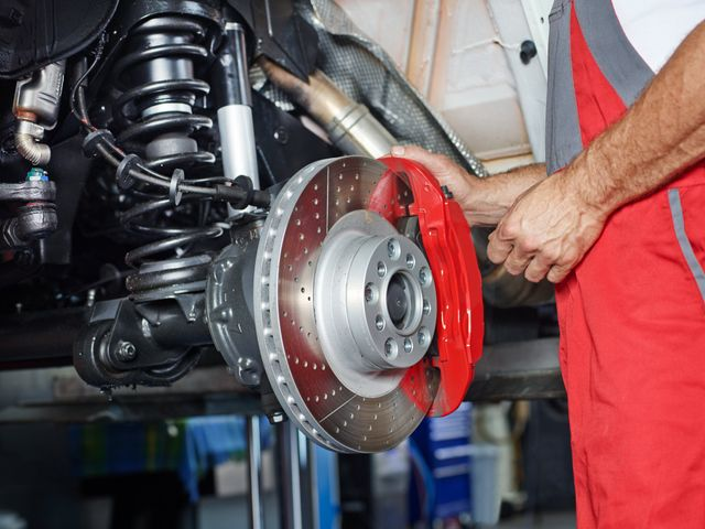 Our mechanic repairing the brakes of a car in Loogootee, IN.
