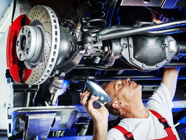 Our mechanic performing car servicing in Loogootee, IN.