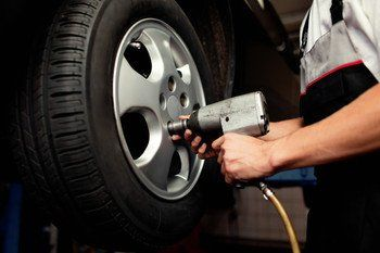 fitting a wheel with an air spanner