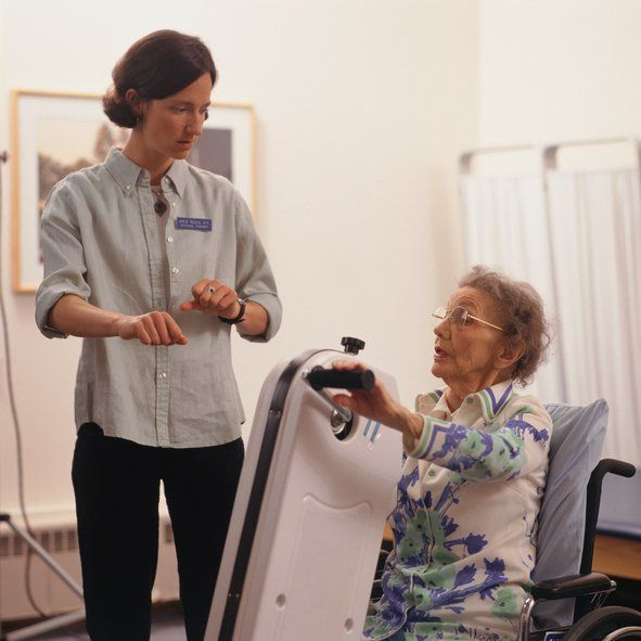 Physical therapist with senior citizen