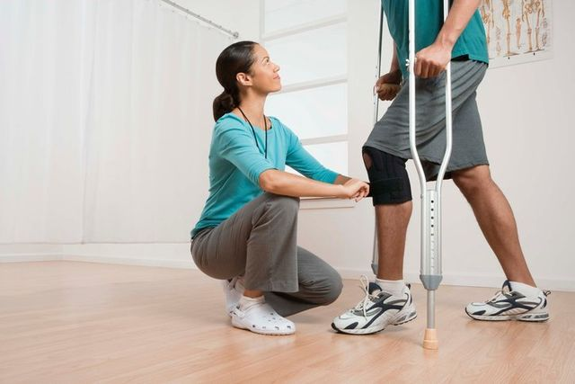 Physical therapist with male