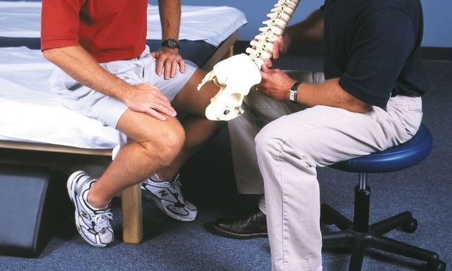Physical therapist explaining lower back