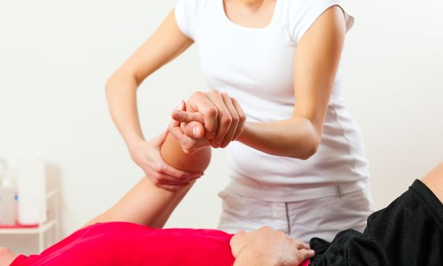 Woman doing joint manipulation
