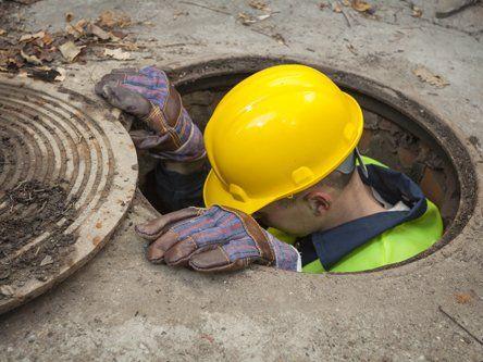 Man going inside main hole