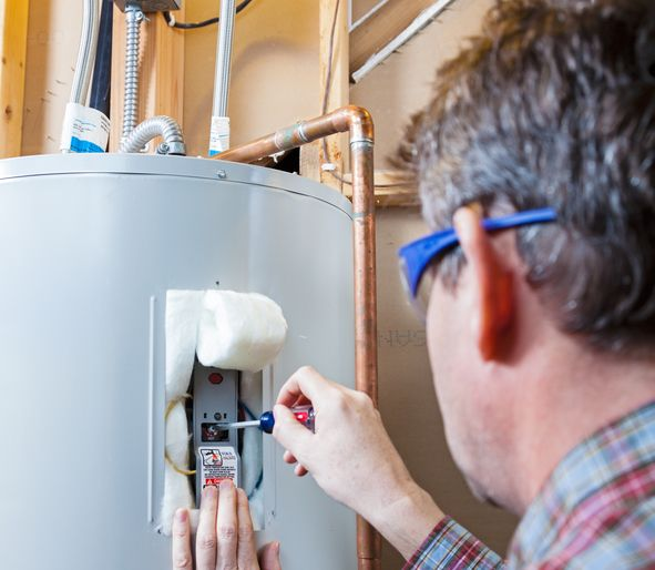 Plumber installing a new water heater
