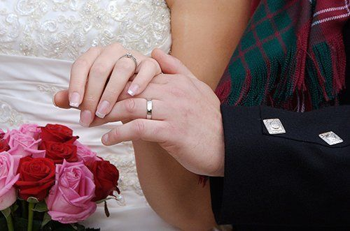 Women holding  hand of the groom in Sussex