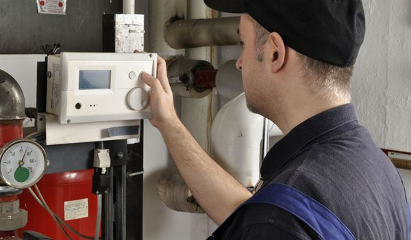 heating company worker sets thermostat in Thomasville, NC
