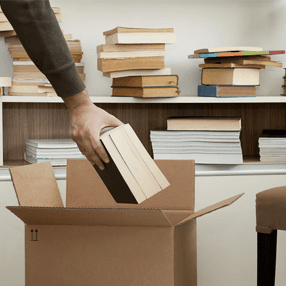 books being put into carton boxes