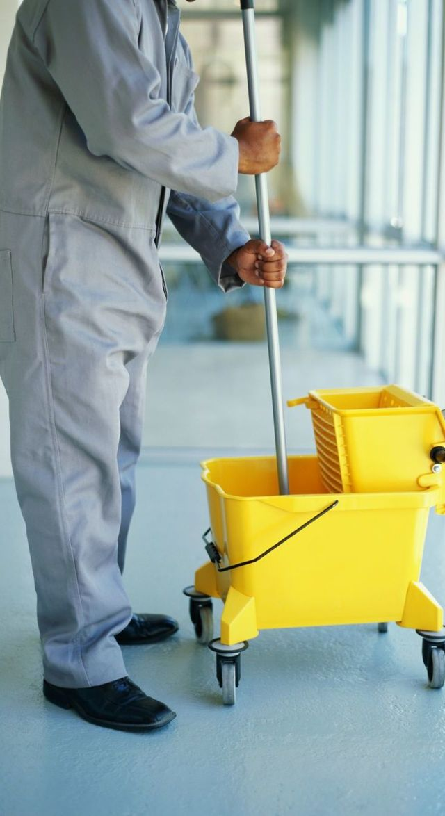 Man using mop for general cleaning in Wellington