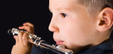 Young flure player playing flute