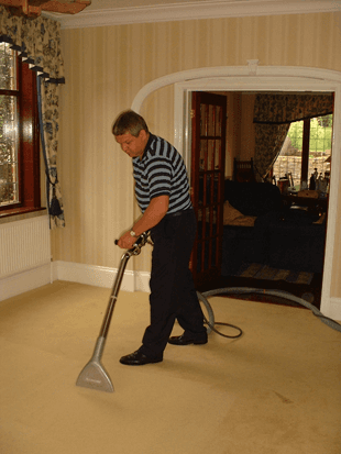 John at AbiMat Cleaning Services cleaning a carpet