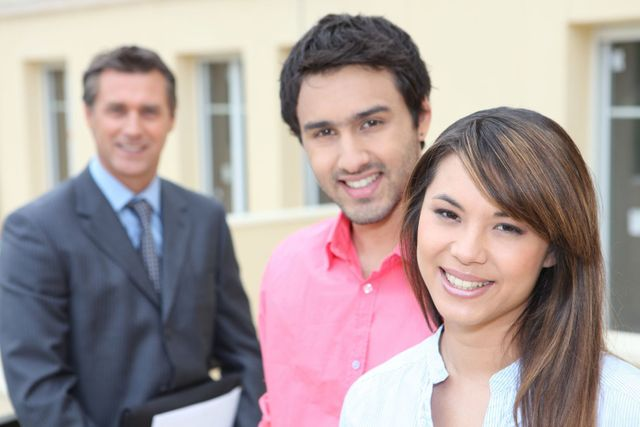 Couple with a property consultant in Hibiscus Coast