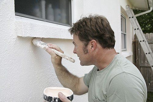 Professional House Painter painting home Buffalo, NY