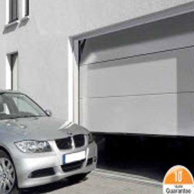 Sectional garage doors and car